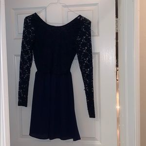 A dark blue dress with bow on the back.